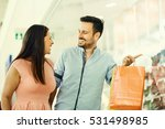 happy couple in shopping mall.  | Shutterstock . vector #531498985