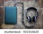 audiobook headphones and book...