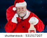 Portrait Of Santa Standing With ...