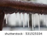 icicles hanging from a brown... | Shutterstock . vector #531525334