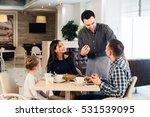 friendly smiling waiter taking... | Shutterstock . vector #531539095