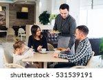waiter serving family in a... | Shutterstock . vector #531539191