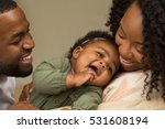 happy family with their baby. | Shutterstock . vector #531608194