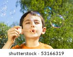 Boy Blowing Soap Bubbles Outdoor