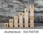 Small photo of ADJUST word on building block