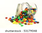 colorful sweets in a glass jar on a white background - stock photo