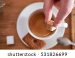 Hand Puts A Sugar Cube In The...