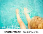 baby sitting near swimming pool. | Shutterstock . vector #531842341