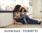 mother sitting on the floor... | Shutterstock . vector #531868735