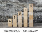 Small photo of ABUSE word on building block