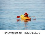 Small photo of Kid taking first lessons in kayaking