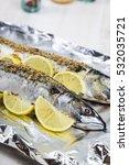 raw mackerel in foil close up.... | Shutterstock . vector #532035721