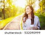 happy young woman walking in...   Shutterstock . vector #532090999