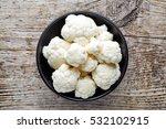 Bowl Of Cauliflower On Wooden...