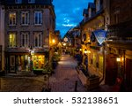 Small photo of QUEBEC CITY, CANADA - November 27, 2016: Rue du Petit-Champlain at Lower Old Town (Basse-Ville) decorated for Christmas at night