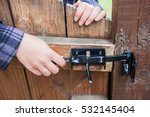 Young Woman Opening Lock On...