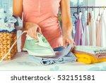 closeup of woman ironing... | Shutterstock . vector #532151581