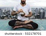 man practice yoga rooftop...