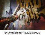 Graffiti Artist Painting With...