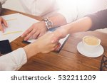 Small photo of Business handshake at office corporate meeting, contract conclusion and successful agreement concept. Closeup of unrecognizable businesswoman and other woman hands meet at wooden table background.