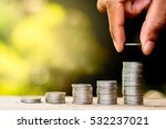men hand are sorted coins on a... | Shutterstock . vector #532237021