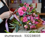 Woman Making A Bouquet Of Rose...