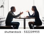 Small photo of Man and woman in discussions in the restaurant