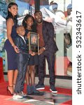 Small photo of LOS ANGELES, CA. October 10, 2016: Kevin Hart & wife Eniko Parrish & his children Hendrix Hart & Heaven Hart at the Hollywood Walk of Fame Star Ceremony honoring comedian Kevin Hart.