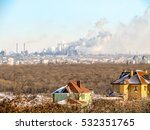 Small photo of The ecological concept of houses in the countryside: comfortable beautiful country houses in the foreground and dirty smoky fumy city with great emissions from industrial plants at the background.