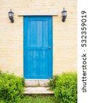 Wooden Blue Door On The Brick...