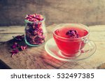 Stock photo tea made from tea rose petals in a glass bowl on wooden rustic background toned image 532497385