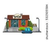 facade shop in town with car...