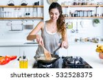 portrait of young woman frying... | Shutterstock . vector #532528375