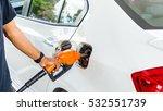 closeup hand pumping fuel... | Shutterstock . vector #532551739