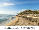 Stock photo early sunset over the beach in saint gilles les bains a famous resort town in the reunion island 532587205