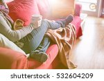 woman sitting on a couch... | Shutterstock . vector #532604209