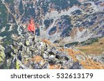 Isolated Woman Climber On Rock...