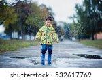 little boy in raincoat and... | Shutterstock . vector #532617769