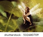 Small photo of Fairy with dragonfly wings.