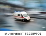 Small photo of Ambulance in the city on a blurred background
