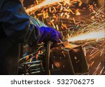 Small photo of Flame sparks with electric grinder the swaying back and forth all the time