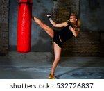 female fighter kicks a boxing... | Shutterstock . vector #532726837