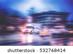 An Ambulance Racing Through The ...