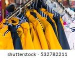 bright autumn raincoats hanging ... | Shutterstock . vector #532782211