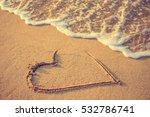 Heart Drawn On The Beach Sand...