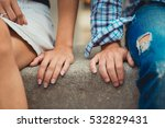hands of young couple in love... | Shutterstock . vector #532829431