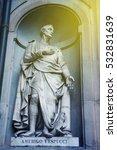 Small photo of Statue of Amerigo Vespucci the famous Italian explorer, financier, navigator and cartographer in Uffizi Gallery, Florence, Italy with sun flare