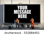 A Large Outdoor Billboard With...