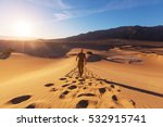 hiker in sand desert. sunrise... | Shutterstock . vector #532915741