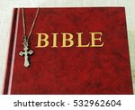 red bible book and a metal... | Shutterstock . vector #532962604